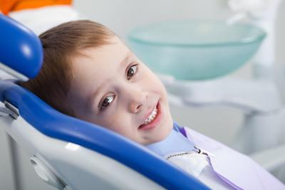 Child in dental chair | Dentist Calgary AB