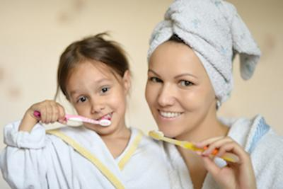Mom and daughter brushing teeth | Dentist Calgary AB