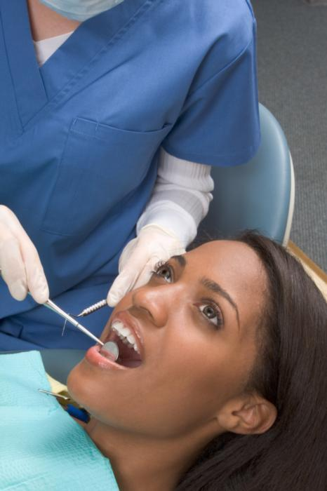 woman getting dental exam | Dentist Calgary AB