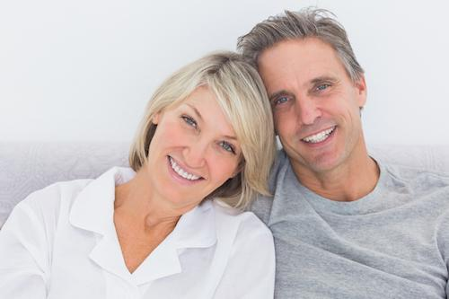 Couple in gray smiling | Dentist Calgary AB