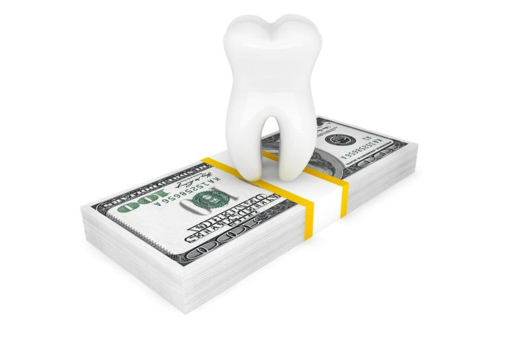 Illustration of tooth on top of money | Dentist Calgary AB