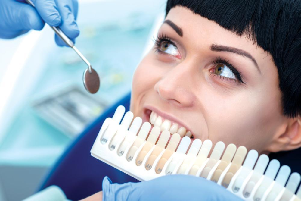 Woman getting teeth whitened | Dentist Calgary AB