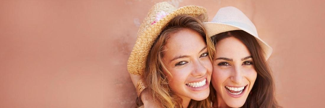 Two women smiling | Dentist South Calgary AB